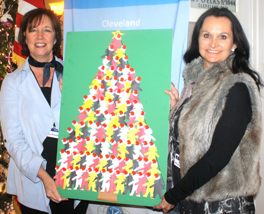 TRACI HAMILTON, left, and June Montgomery, a Kiwanian who works with Head Start, display the Kiwanis Club's Coats for Children Christmas tree, which has already been completed for this holiday season. The club is providing 93 coats, or outfits, for Head Start students.