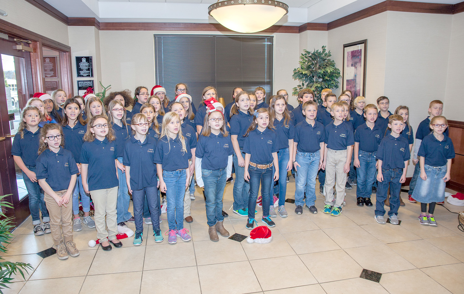 THE MICHIGAN AVENUE SCHOOL Chorus performed Christmas carols for the employees and customers of Athens Federal Community Bank, Friday morning.