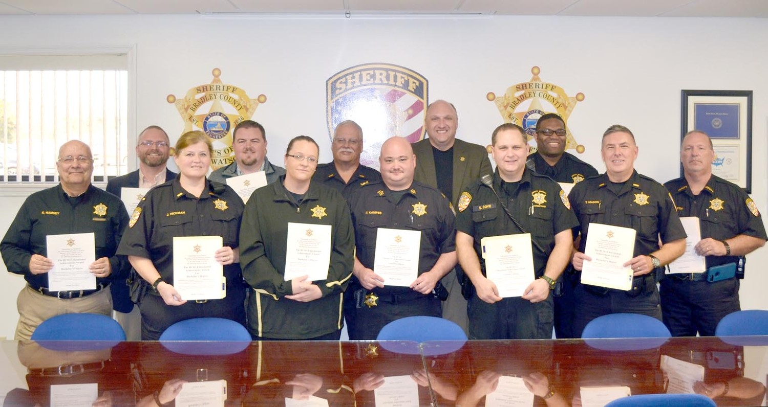 "COLLEGE GRADUATES at the Bradley County Sheriff's Office were recently recognized.  From left  front: Admin. Asst. Michael ""Ed"" Ramsey, Lt. Joleen Hickman, Sgt. Carrie Ward, Sgt. Jeremy Kanipes, Officer Scott Dove, Lt. Tim Mason. BACK, Detective David Michaels, Detective Matt Parris, Lt. Bob Hancock, Sheriff Eric Watson, Officer N. Lynn Bafford, and Deputy James Dearth."