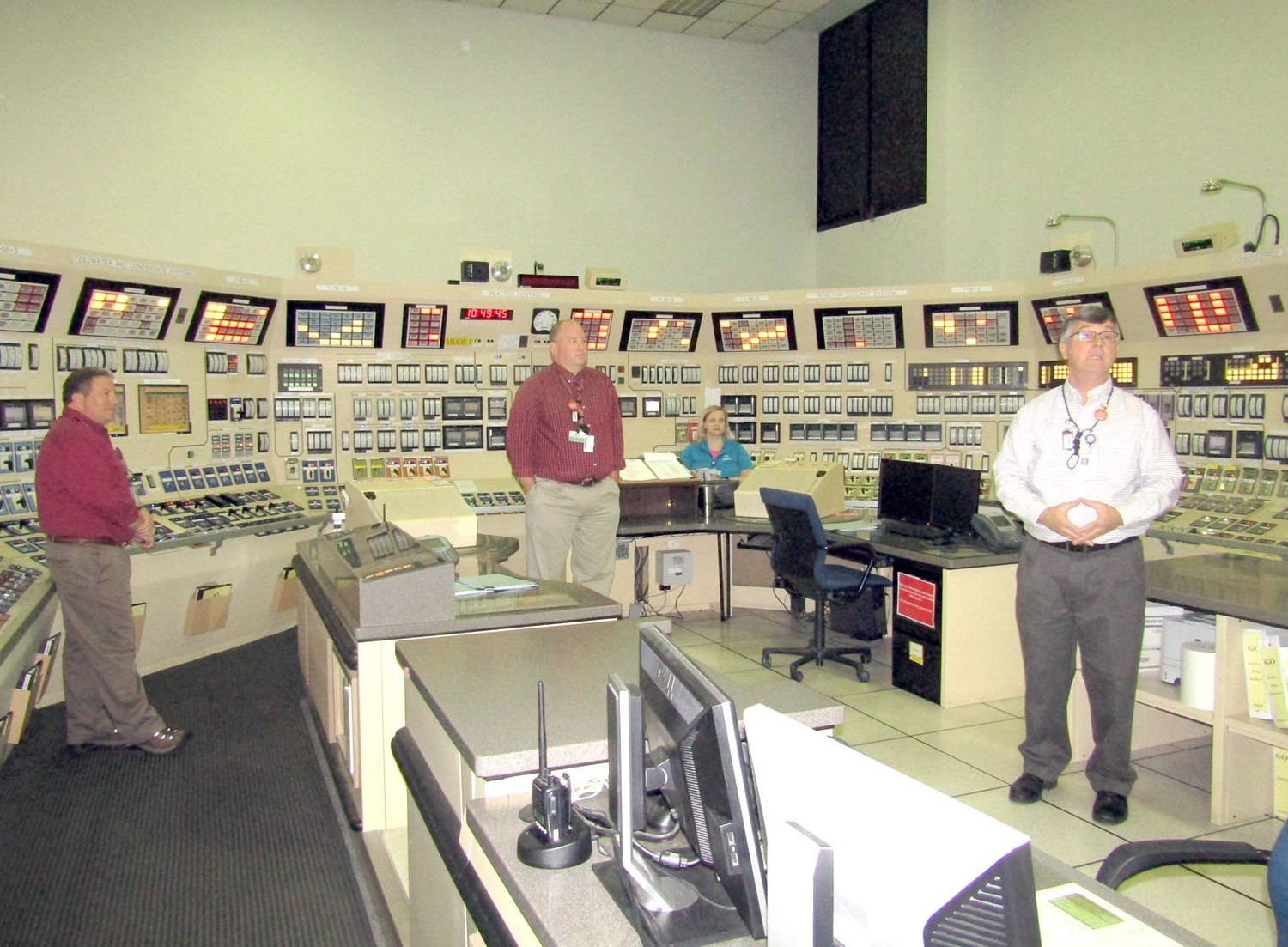 Harold Siercks, Sequoyah operations lead instructor, right, shows the plant's control room simulator where emergency scenarios are played out and practiced.