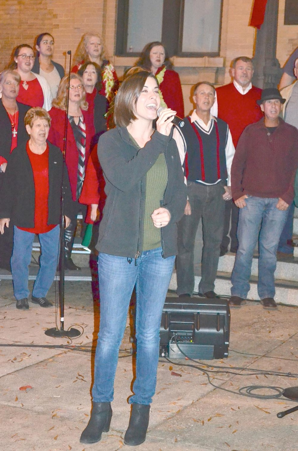 TATUM BRINKMAN sings at Friday's lighting of the Cleveland Christmas tree.