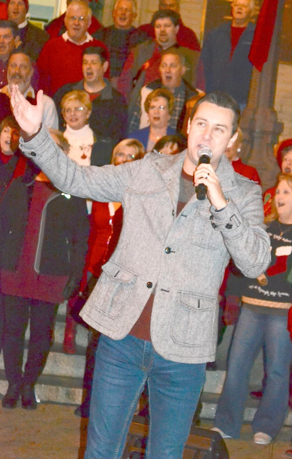 DR. TYLER BRINSON performed with the First Baptist Church Friday at the downtown Christmas tree lighting.