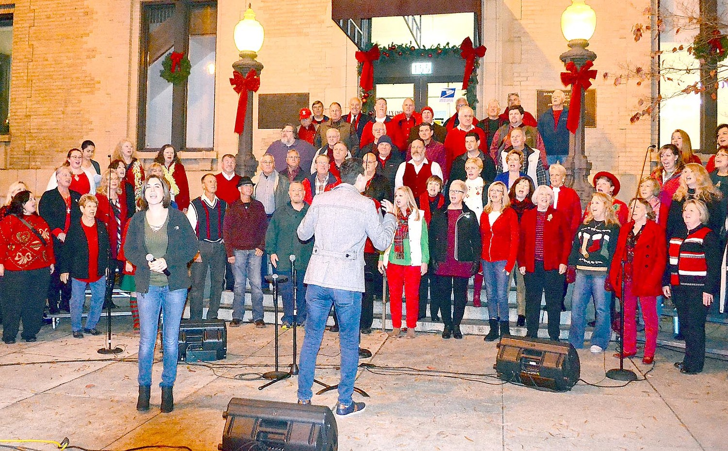 THE FIRST BAPTIST CHURCH choir opened the Christmas tree lighting in downtown Cleveland Friday.