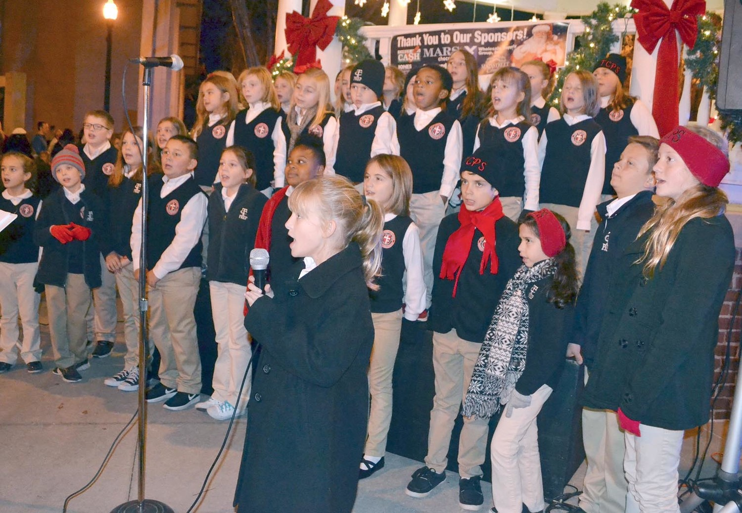 THE TENNESSEE CHRISTIAN PREPRATORY SCHOOL choir sang at the bandstand at the Bradley County Courthouse Square Friday.