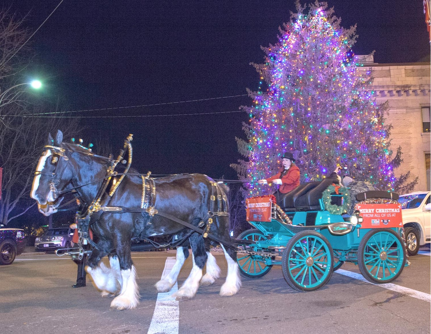 A FAMILY ENJOYS a free carriage ride around the downtown area as part of the Christmas Tree Lighting event on Friday night.