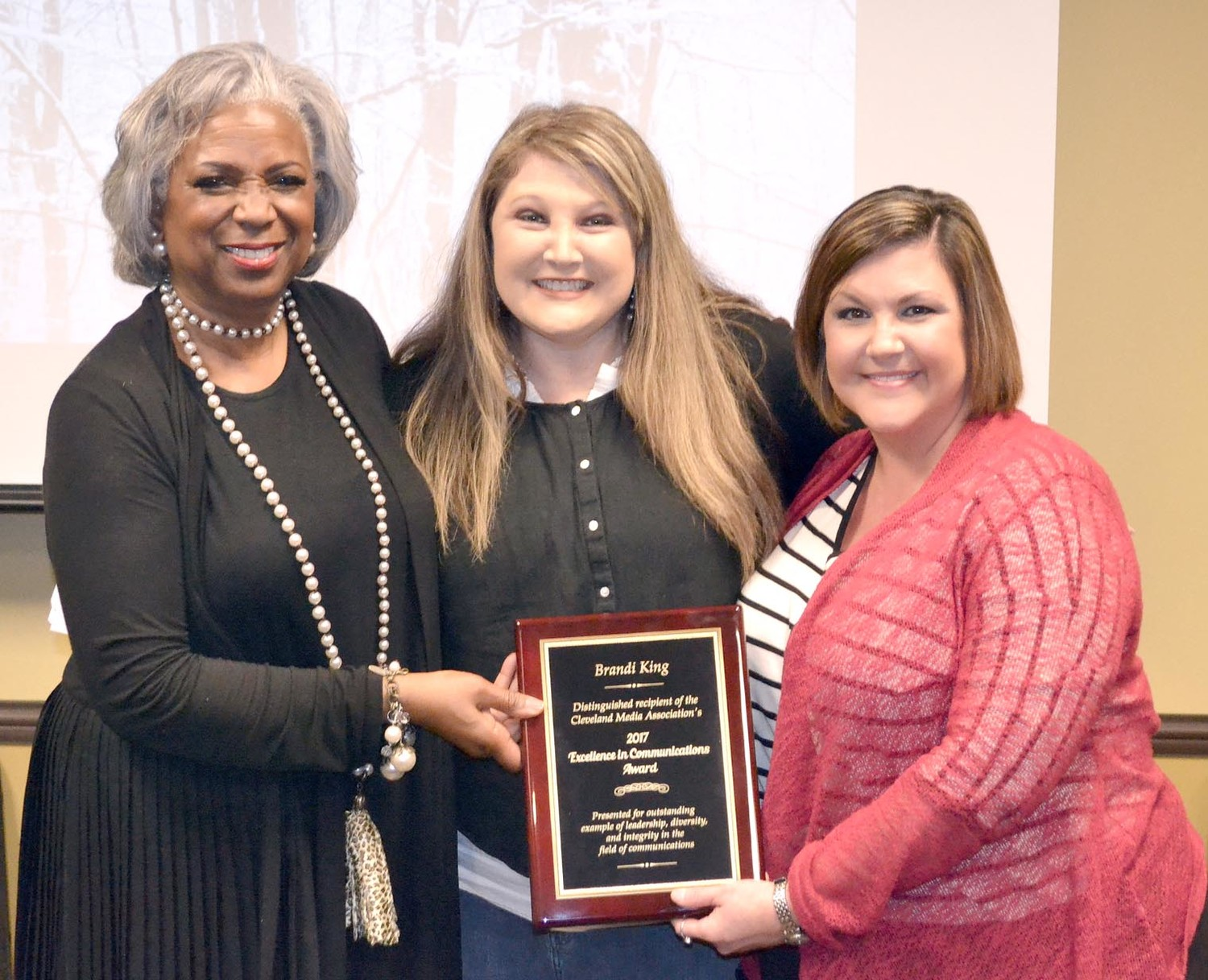 Toni Miles and Meagan Jolley present Brandi King the CMA Excellence in Communications award. Pictured from left to right, Toni Miles, President of CMA; Meagan Jolley, Vice President of CMA; and Brandi King, award recipient.