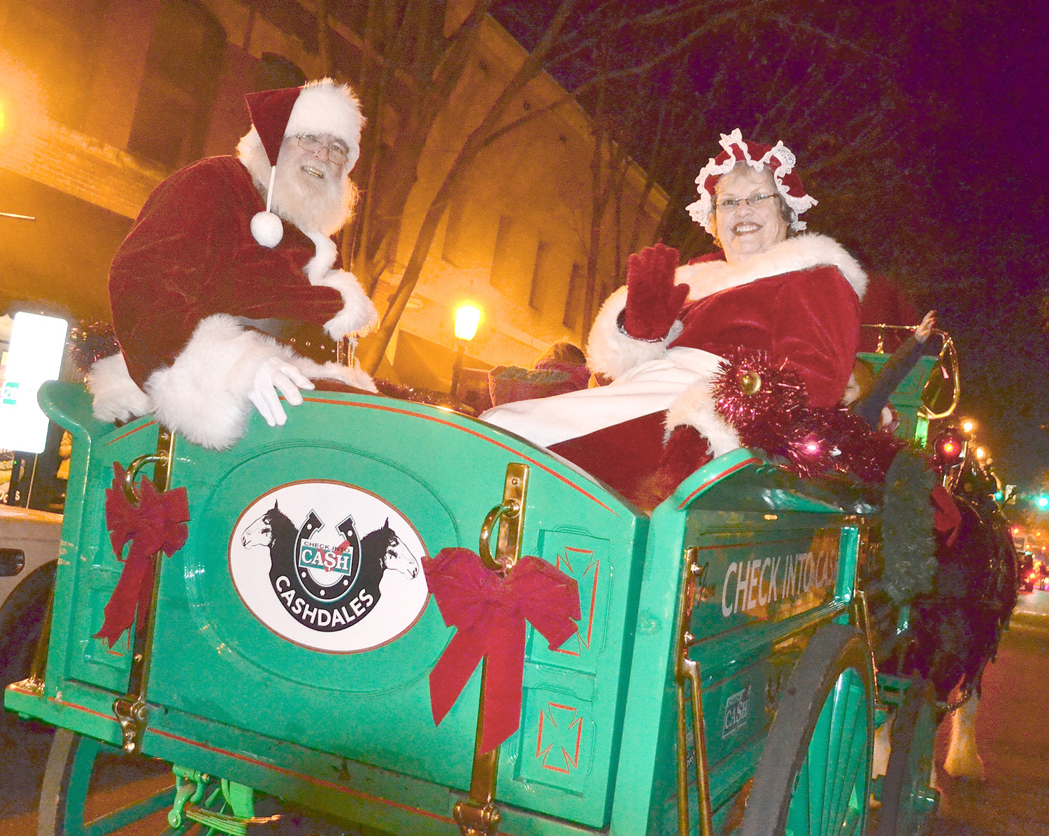 SANTA CLAUS AND MRS. CLAUS  rode with the Cashdales at Saturday's downtown Christmas parade.