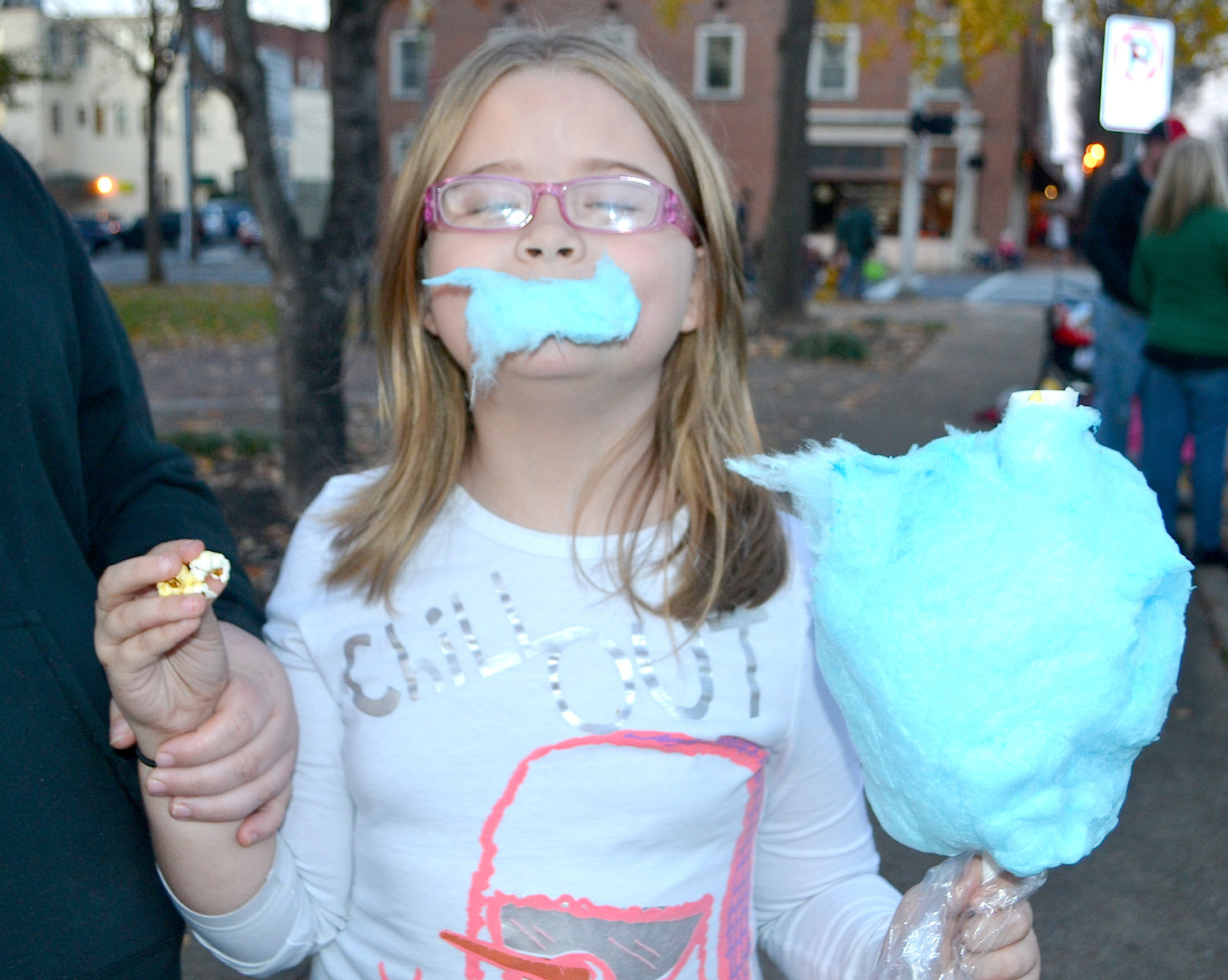 ALLYSON JONES enjoys her cotton candy while waiting for the Christmas parade to start.