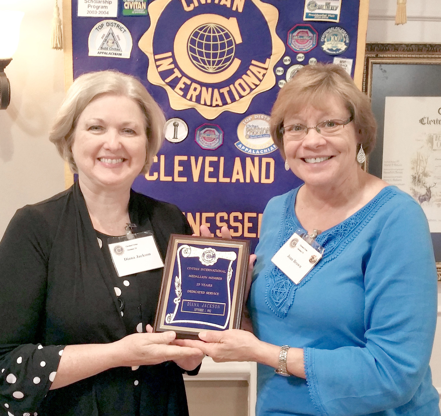 Diana Jackson recently receive a plaque  from Civitan International honoring her for 25 years of dedicated service to Civitan. She is currently past president of the local club.  Making the presentation is Joan Brown, Cleveland Civitan president.