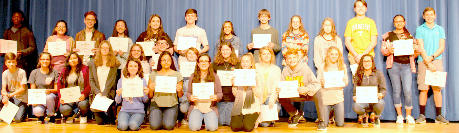 EIGHTH-GRADERS from Cana Kirksey's English classes at Cleveland Middle School receive special honors for completing the National Novel Writing Month Young Writers Program.