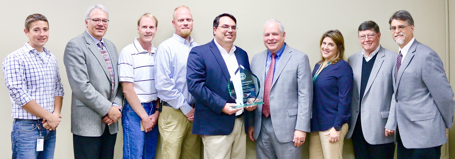 OLIN RECEIVED the Volunteer STAR Award award Thursday. From left are Nick Curtsinger, Health Safety and Security supervisor; Jim Flanagan, TOSHA assistant administrator; Stephen Barnette, Olin Responsible Care manager; Calvin Wyatt, TOSHA; Chris Anziano, plant manager; Steve Hawkins; TOSHA assistant commissioner; Maria Krysa, global director of Olin Responsible Care; Rick Hall, director of manufacturing; and David Blessman, TOSHA VPP manager.