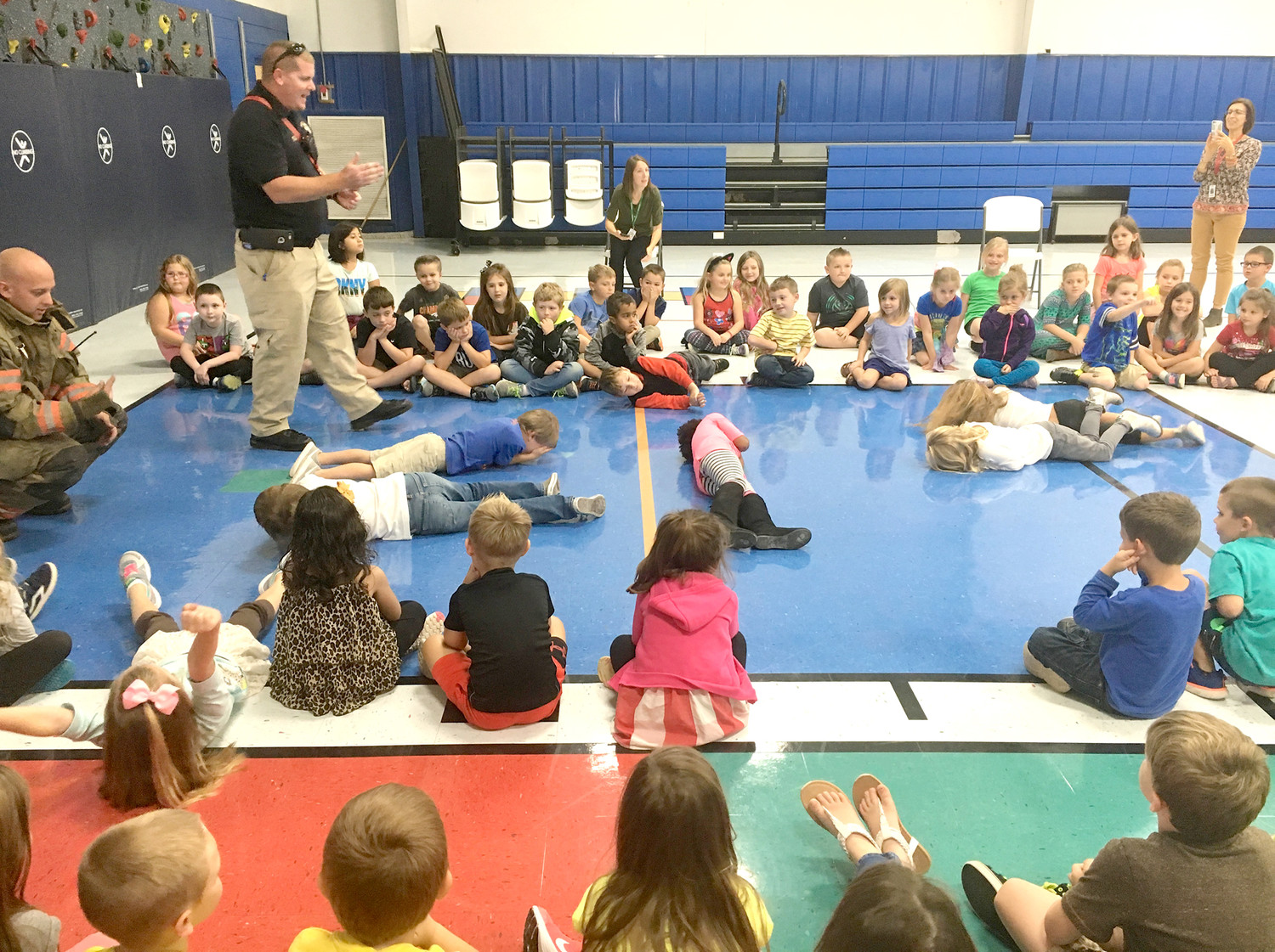 "SAFE STUDENTS at Valley View Elementary School show how they can ""stop, drop and roll"" after learning from visiting representatives of Bradley County Fire-Rescue."