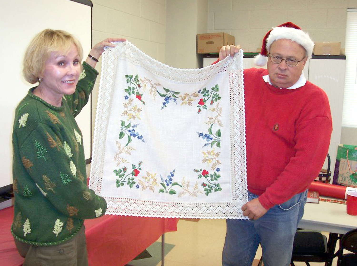 "The Polk County Retired Teachers will meet Thursday at noon, at First Baptist Church, for the annual Christmas auction and luncheon, which will be catered by Kathy's Cownty Kitchen. President Marian Presswood encourages all members to be present and invites anyone from the community to donate an auction item or monetary donation, which all goes toward the PCRTA Scholarship Fund to help a deserving Polk County and Copper Basin high school student who plans to enter the field of education. Call Presswood at 423-338-4506; donations can be picked up or dropped by the PCHGS Genealogy Library at the corner of Commerce and Poplar streets. This photo is from of one of the past auctions with the late Mike Witt, who was also known as the ""Santa Auctioneer"" for several years, and former Superintendent of Schools Deborah Williams."