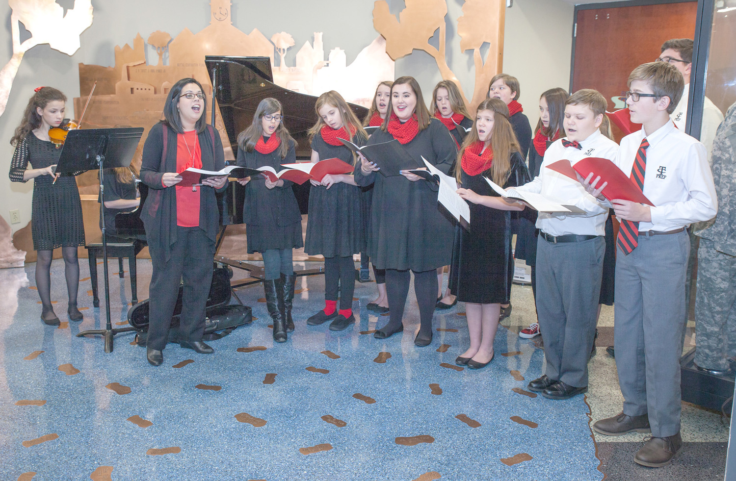 STUDENTS FROM TENNESSEE Christian Preparatory School sang carols during the Christmas Open House on Sunday at the Museum Center at Five Points.