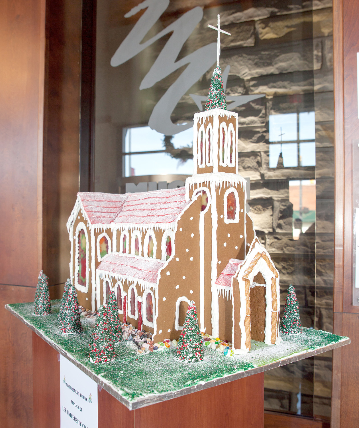 "REPRESENTATIVES MARINA SEPENUK and Valentina Mantsevich of Just a Bakery brought with them to the Christmas Open House event a masterful example of a gingerbread house: The Lee University Chapel.  In addition to the meticulous gingerbread and frosted detail, the bakers fashioned melted sugar ""stained glass"" windows for the display."