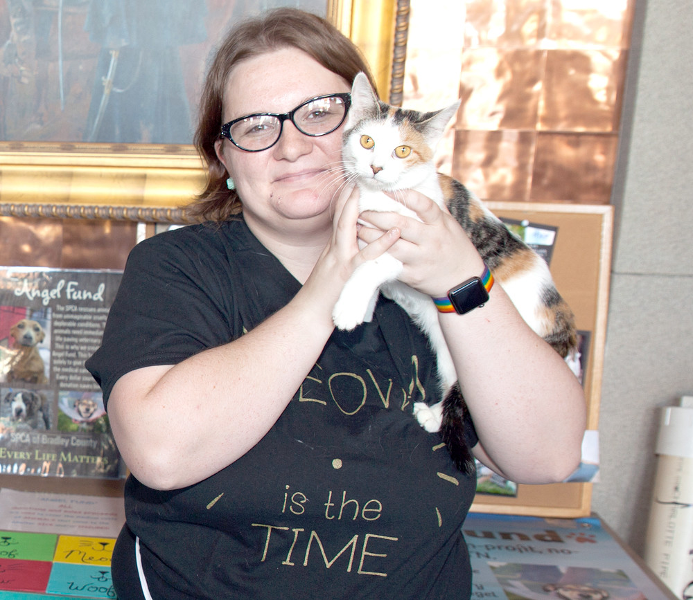 THE SPCA of Bradley County was on hand at the Christmas Open House event with plenty of adoptable cats and dogs.  Jessica Taylor holds Donna the cat for a quick photo before showing the feline to some adoring families.