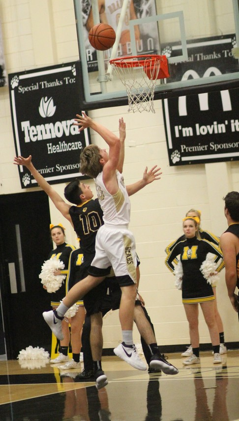 BRADLEY CENTRAL junior Tyler Ferguson (20) takes the ball to the hoop for two of his team-high 16 points in Tuesday evening's District 5-AAA opener against McMinn County at Jim Smiddy Arena.