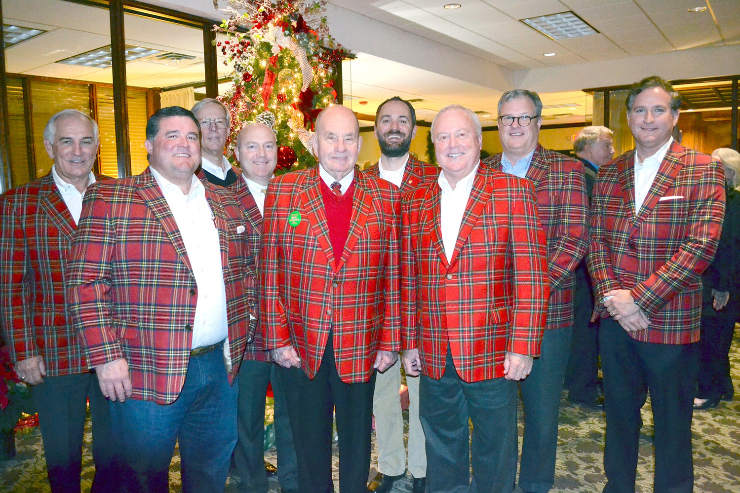 MANY MAINSTREET MEMBERS remembered Bobby Taylor by wearing a plaid jacket, one of Taylor's trademarks. From left are Scott Taylor, Andy Figlestahler, Joe Mason, Tony Martin, Mayor Tom Rowland, Nicholas Lillios, Lou Patten, Julian Sullivan and Tucker Duncan. Taylor was wearing his father's blazer, which he said is 35 years old.