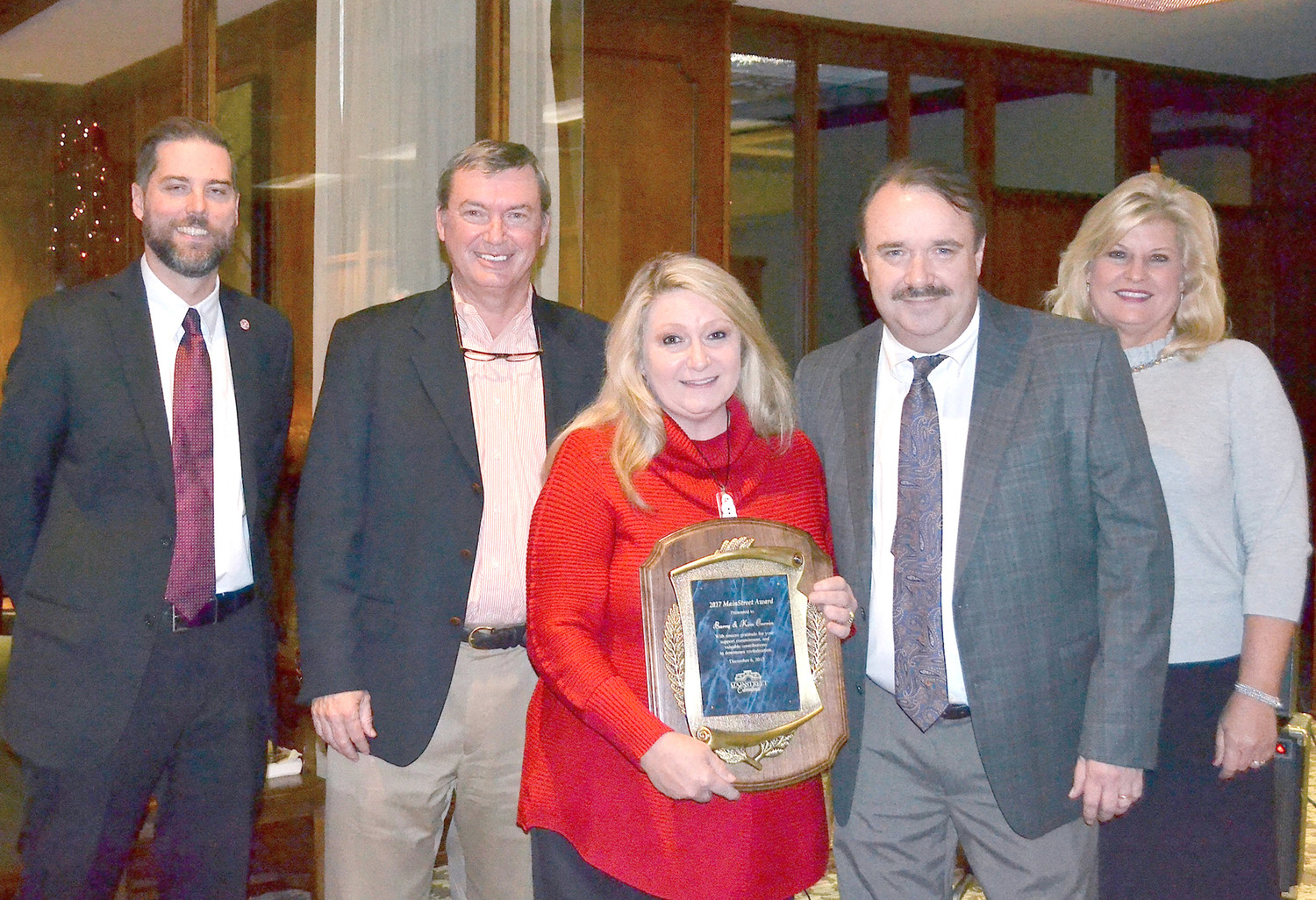 BARRY AND KIM CURRIN have won the 2017 MainStreet Cleveland Award. From left are Corey Divel, award presenter, MainStreet board chairman Keith Barrett, Kim and Barry Currin, and MainStreet Cleveland Executive Director Sharon Marr.