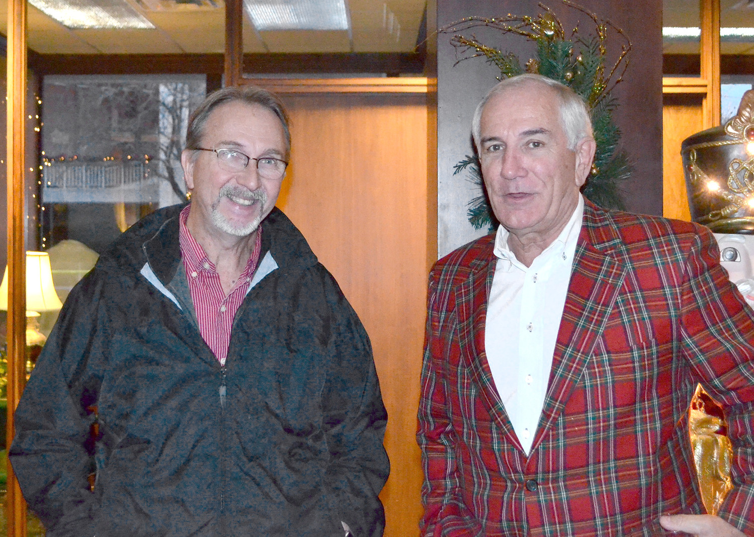 JERRY SHANNON, left, and Scott Taylor have a conversation at Wednesday night's MainStreet Cleveland Christmas party.