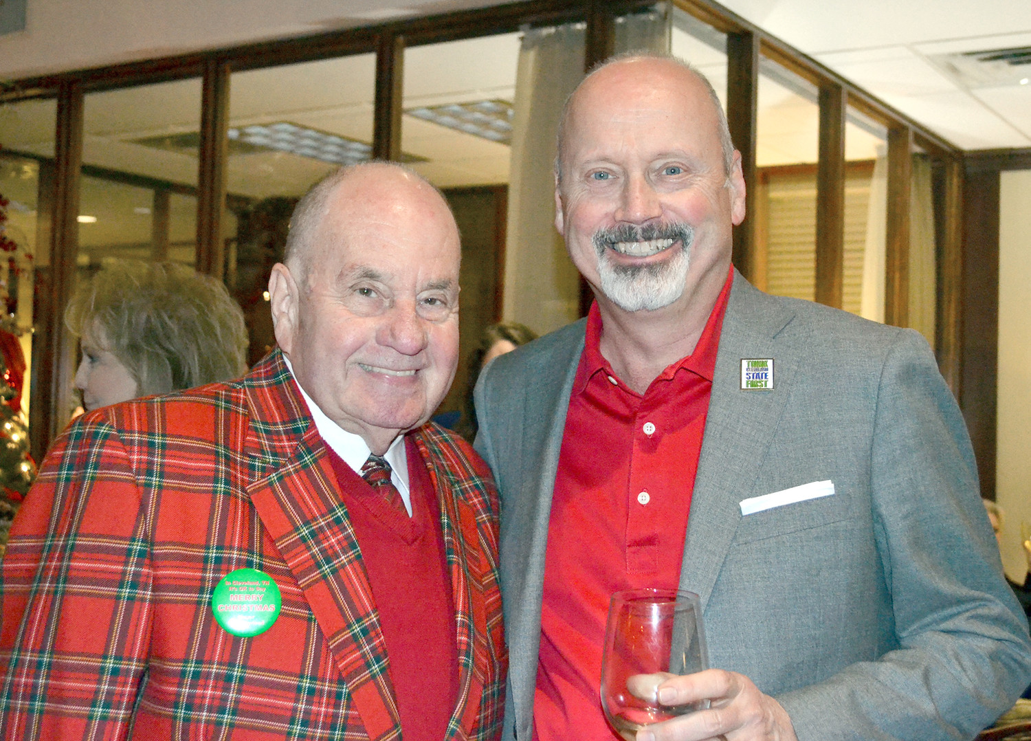 CLEVELAND MAYOR Tom Rowland, left, and Cleveland State Community College President Dr. Bill Seymour take time for a photo at Wednesday night's MainStreet Cleveland Christmas party.