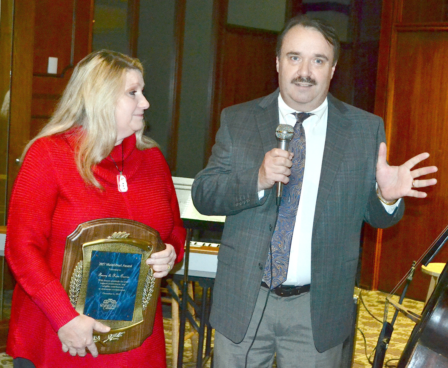KIM AND BARRY CURRIN were surprised when named the 2017 MainStreet Cleveland Award recipients at Wednesday's Christmas party, held at the Bank of Cleveland.