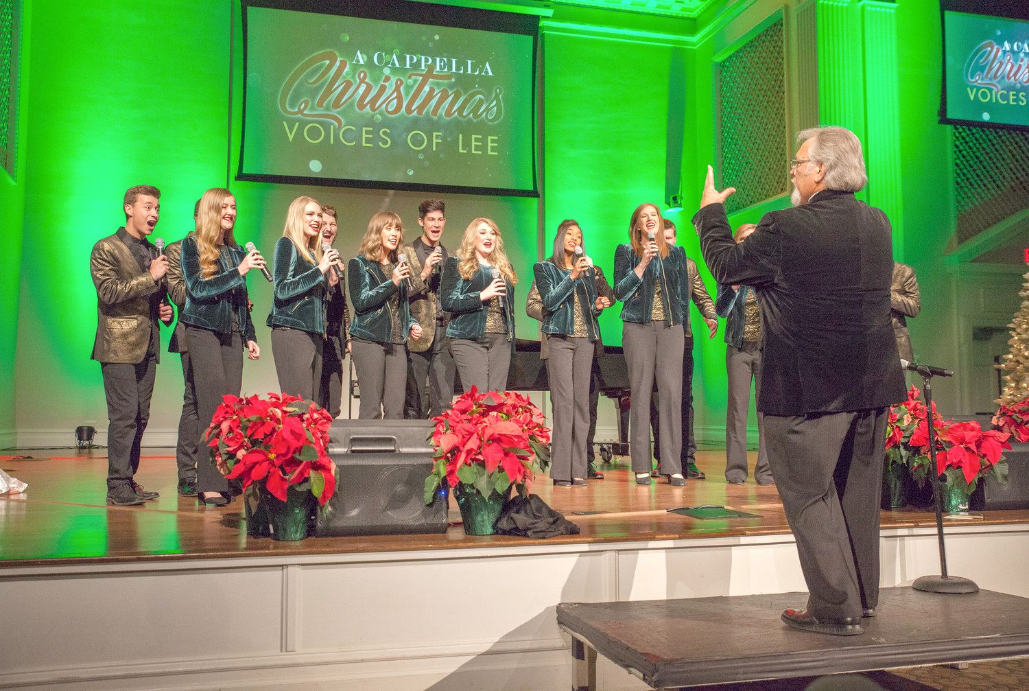 VOICES OF LEE light up Pangle Hall on Wednesday night during the a cappella Christmas concert, where the singers performed songs from their brand new album of the same name.