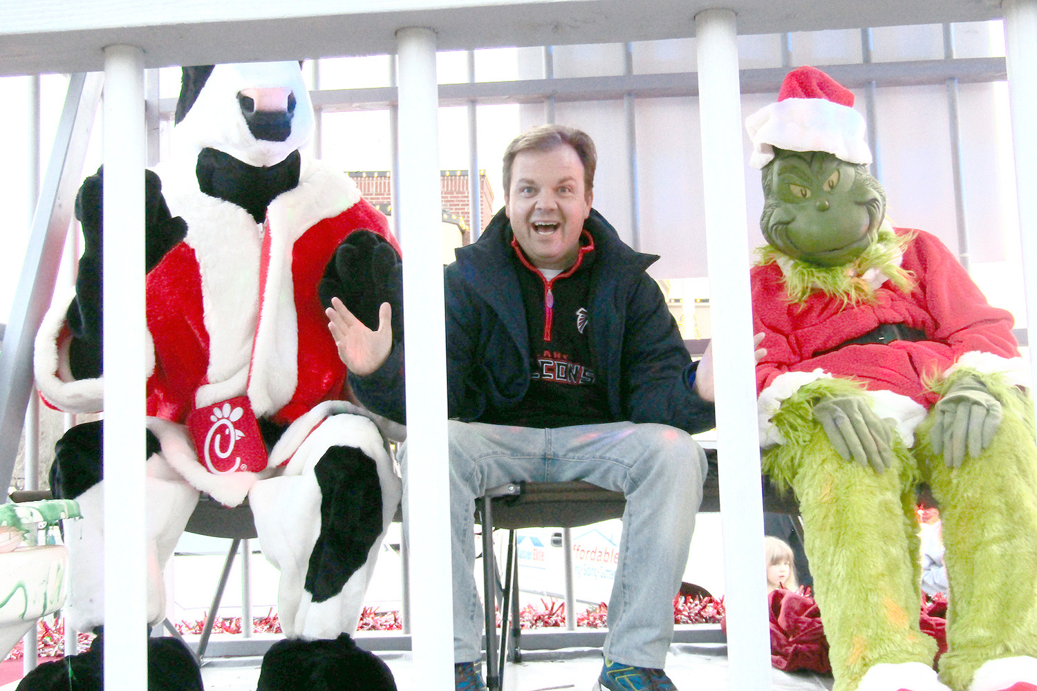 "WCLE RADIO OWNER Steve Hartline is seen in ""jail"" Thursday night, as he was placed in the Bradley County Sheriff's Office Christmas float with the Chick-fil-A cow and the Grinch. Donors to the Empty Stocking Fund voted with their dollars as to who would have to stay the full two hours in the jail cell and Hartline got the short end of the stick after more than $5,500 was raised in the two-hour span — most choosing, with good humor, to leave the radio host incarcerated. The annual drive has now reached more than $62,000 with the grand finale today. Full coverage of the last day will appear in Sunday's Cleveland Daily Banner."