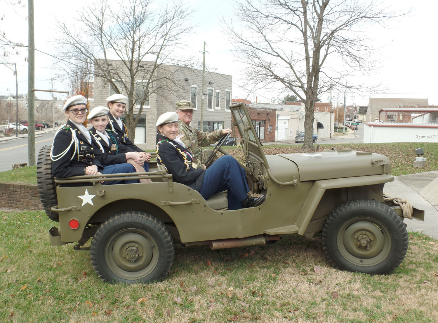 BEFORE A PEARL HARBOR CEREMONY, members of the Bradley Central High School JROTC and their instructor, Sgt. 1st Class Roger Wright, paused for a photo in the Army Jeep that was parked outside for the Pearl Harbor Day remembrance ceremony.  From left are Cadet Marie Culp, Cadet Rachel Fowler, Cadet Olivia McMahan, Cadet Sarah Satterfield and Wright.