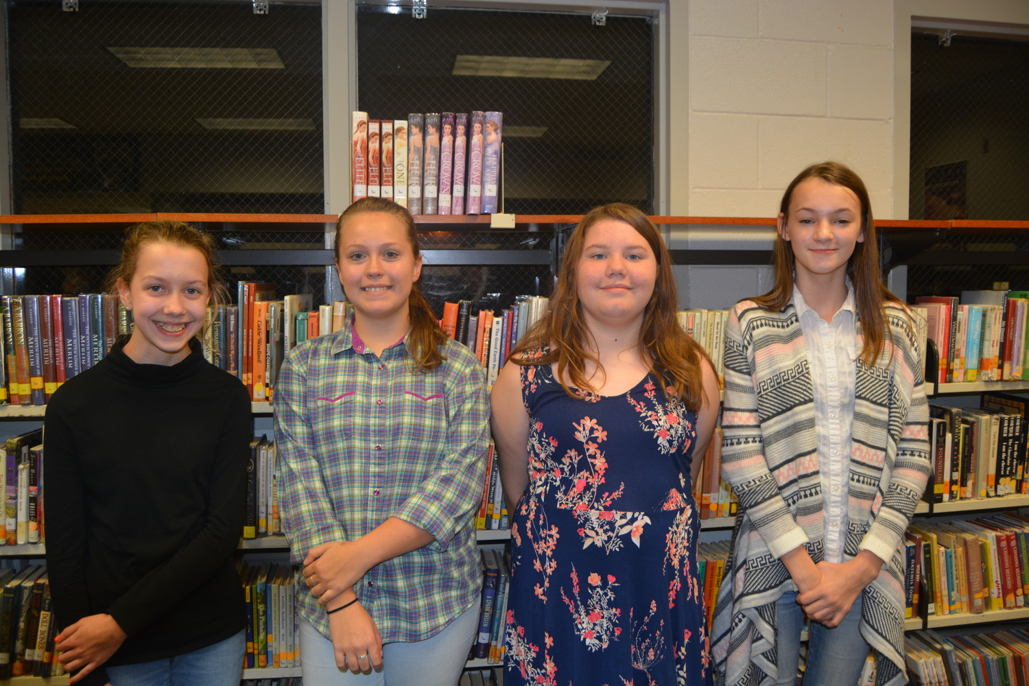 EIGHTH-Grade LFMS Poetry Winners are, from left, Second Place original - Elyse Tingler, First Place original - Emma Grace Geren, Second Place performance - Baylee Ables, First Place performance - Minnie Brock.