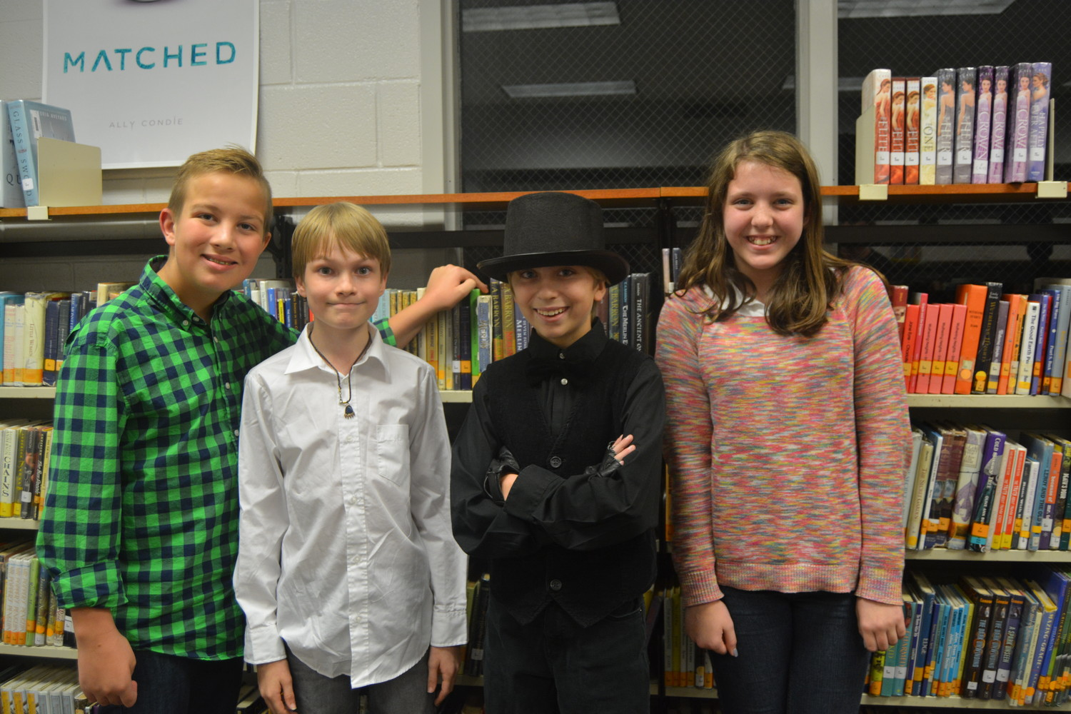 SEVENTH-Grade LFMS Poetry Winners are, from left, First Place performance - Noah Talley, Second Place performance - Gabe Milliron, Second place original - Roland Weatherford, First Place original - Chandler Mills.