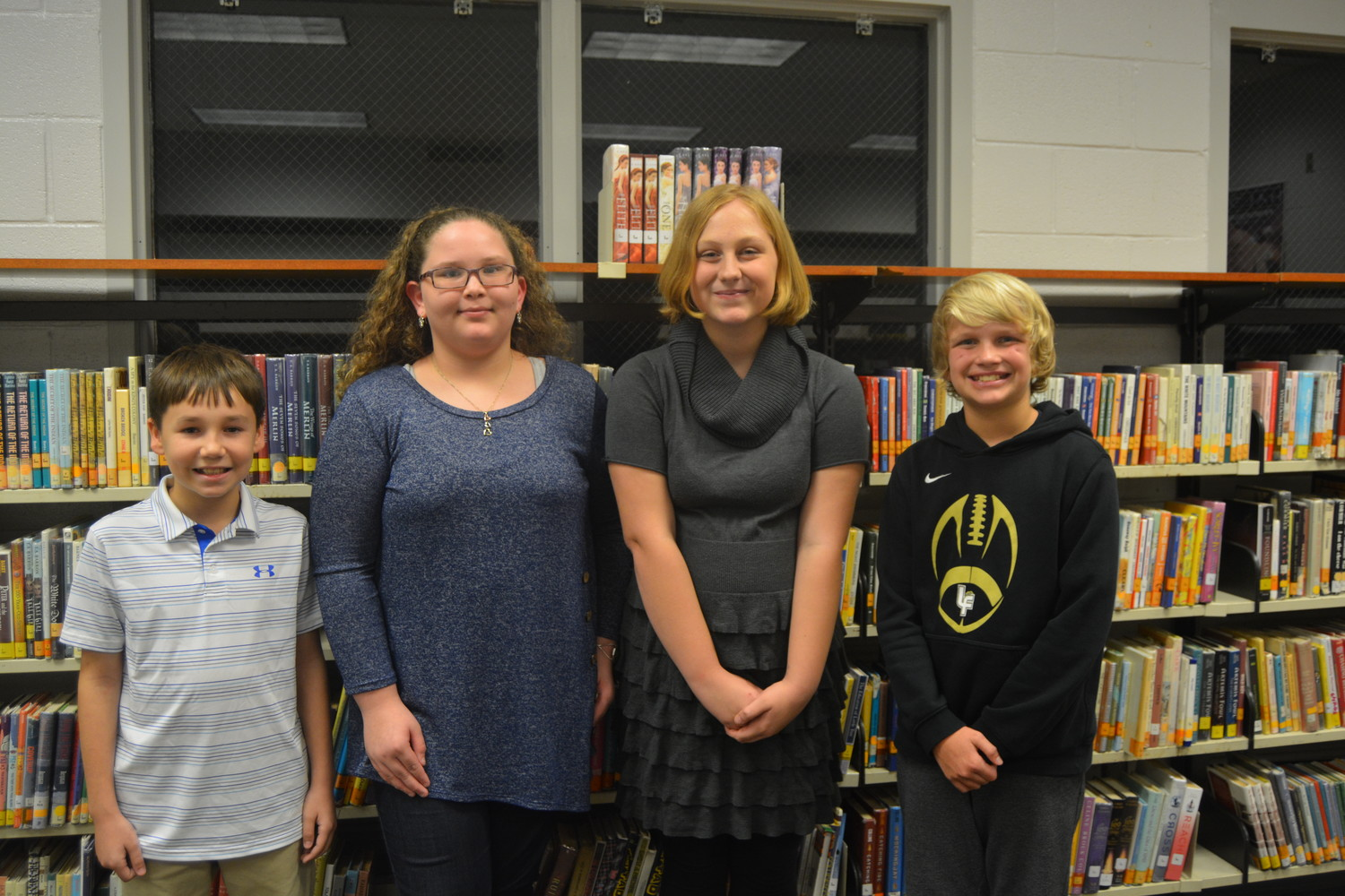 SIXTH-Grade LFMS Poetry Winners are, from left, Second Place performance - Christian Phillips, First Place performance - Emily Bingham, First Place original - Aiden Amos, Second Place original - Hank Adams.