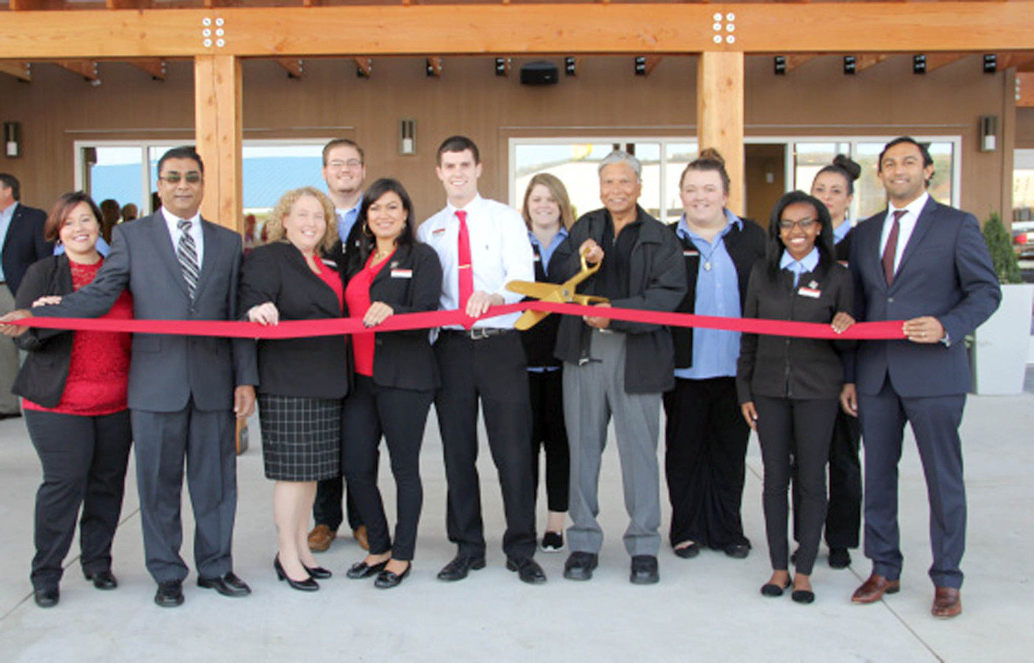 A RIBBON-CUTTING was held recently at TownePlace Suites by Marriott, located at 160 Bernham Drive N.W. in Cleveland. Management and staff are shown during the recent celebration.
