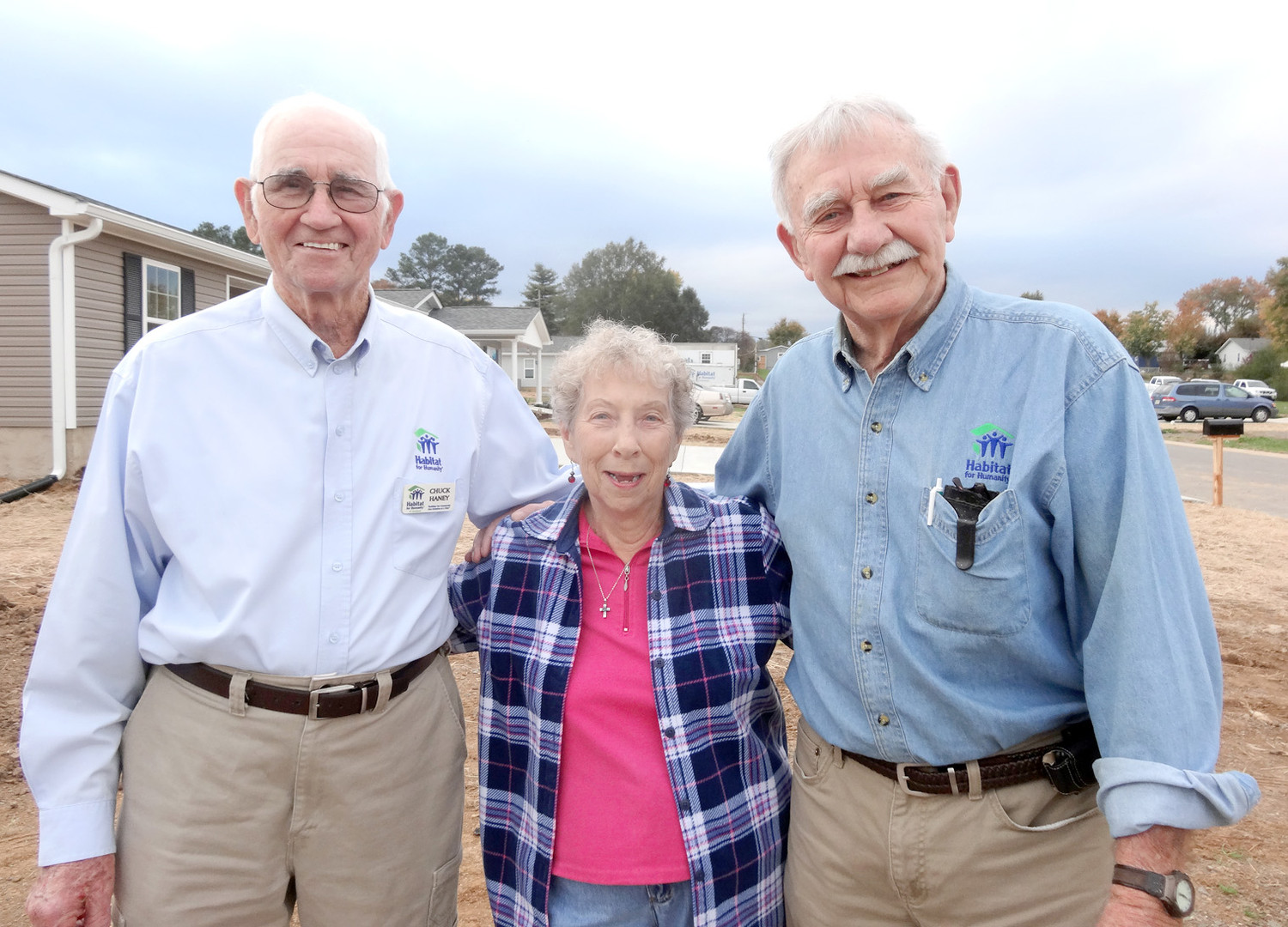 Chuck Haney and Don Rollens were recently honored for their work with Habitat for Humanity of Cleveland. Both have been involved with building homes in the community since the organization began in 1990. From left are Haney, Habitat volunteer Hazel Spain, and Rollens.