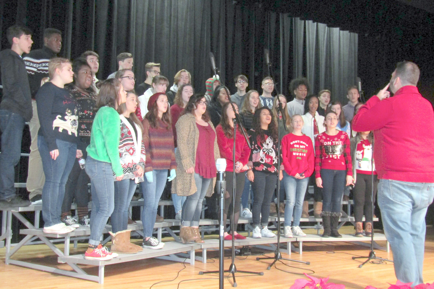The Cleveland High School Renaissance Show Choir was the musical opener for the finale of WCLE's Empty Stocking Fund drive finale on Friday.