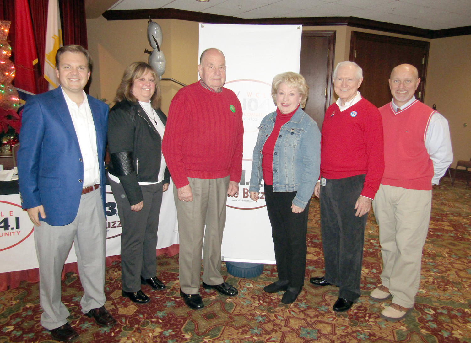 Organizers and supporters of the Empty Stocking Fund are all smiles after the end of record-setting year of donations. From left are Steve Hartline, WCLE; Brenda Lawson; Mayor Tom Rowland; Sandra Rowland, Beecher Hunter, president of Life Care Centers of Cleveland; and Dewayne Williams, WCLE.