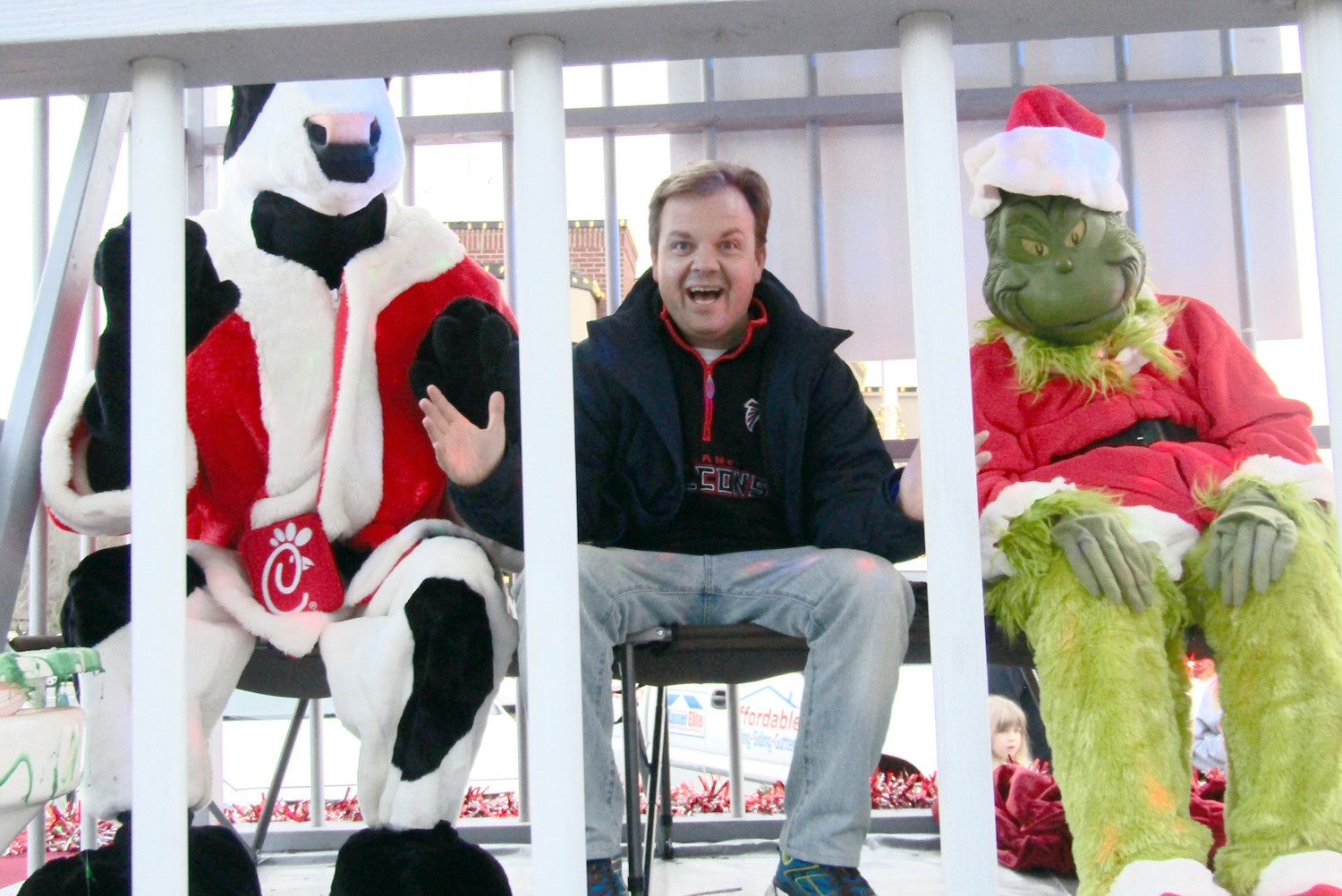 "WCLE's Steve Hartline is seen in ""jail"" Thursday night as he was placed in the Bradley County Sheriff's Office Christmas float with the Chick-fil-A cow and ""The Grinch."""