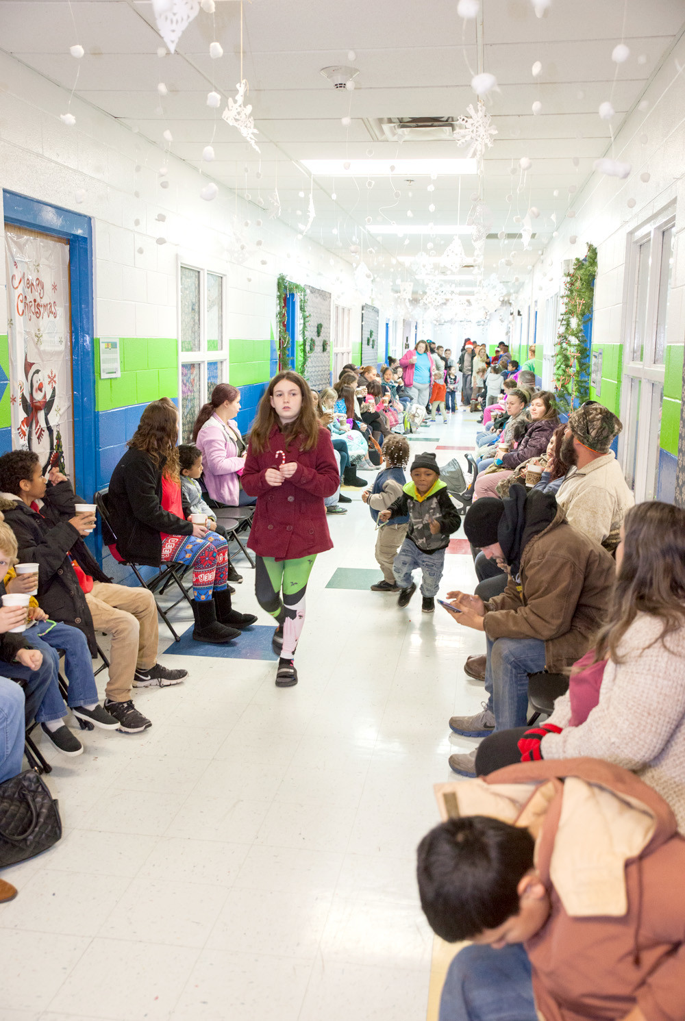 CLEVELANDERS LINED THE HALLS and waited in a heated bus outside of the Boys & Girls Clubs Tucker Unit Saturday morning in anticipation of the Catch the Spirit Christmas Celebration.