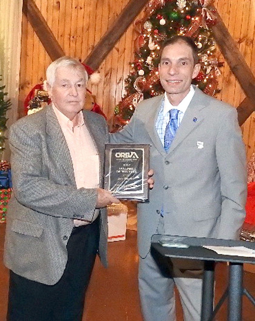 Jerry Franitza, left, is presented the 2017 Builder of the Year Award by ORBA President Chad Dean.