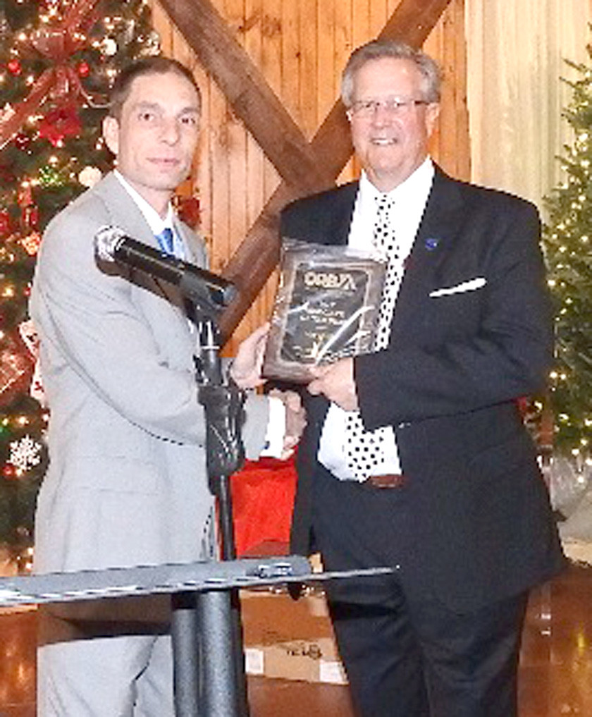 ORBA President Chad Dean, left,  presents the 2017 Associate of the Year Award to Max Phillips.