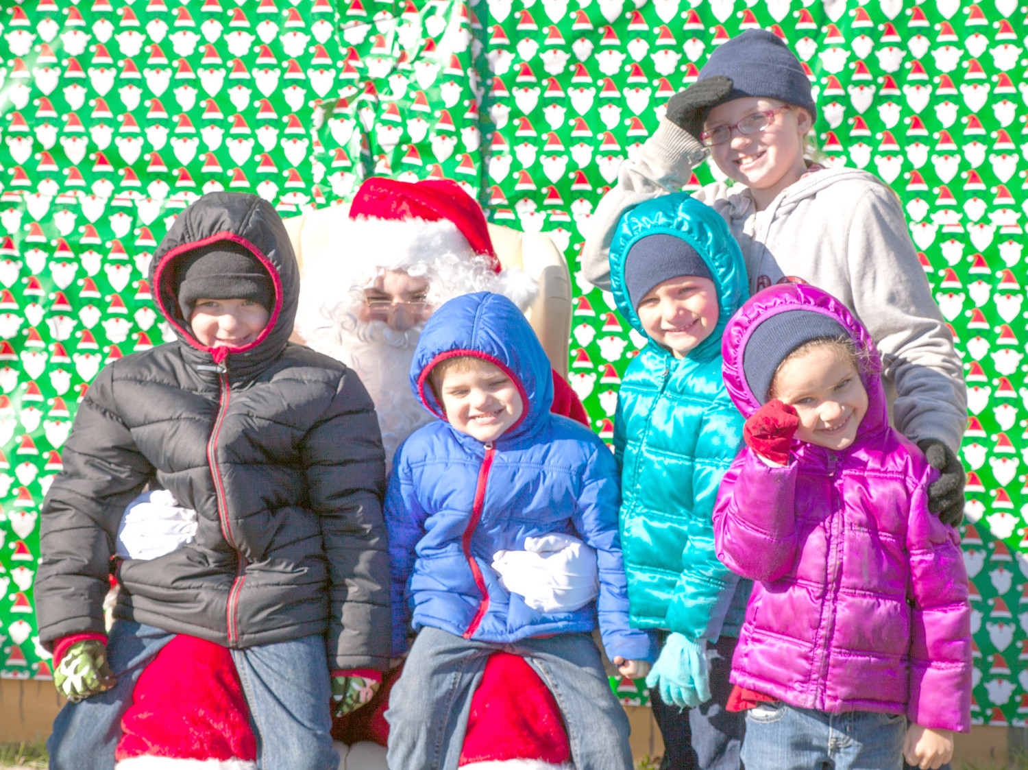 SANTA WAS AT THE Annual Polk County Christmas Parade visiting with children and posing for photos.  Picture from left are Anthony Warfield, Corbin Schaal, Chloe Schaal, Cambree Schaal and Elizabeth Warfield.
