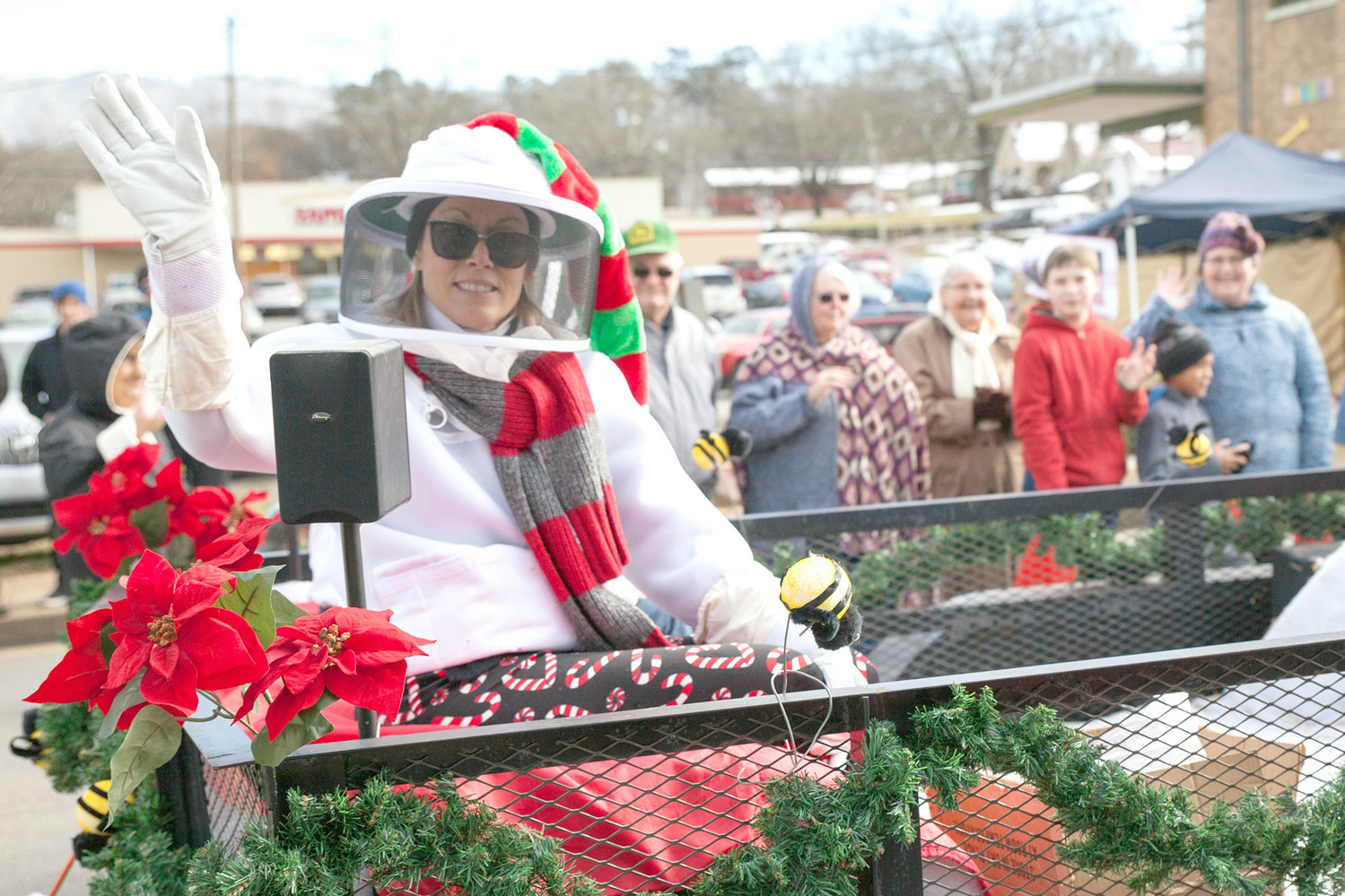 THE OCOEE REGION BEEKEEPERS Association was represented in the parade on Saturday.  This lady waves as several large bees buzz about on the float.
