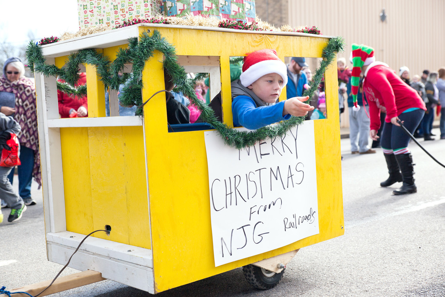 THIS BOY FROM NJG Railroads tosses some candy to a parade attendee.