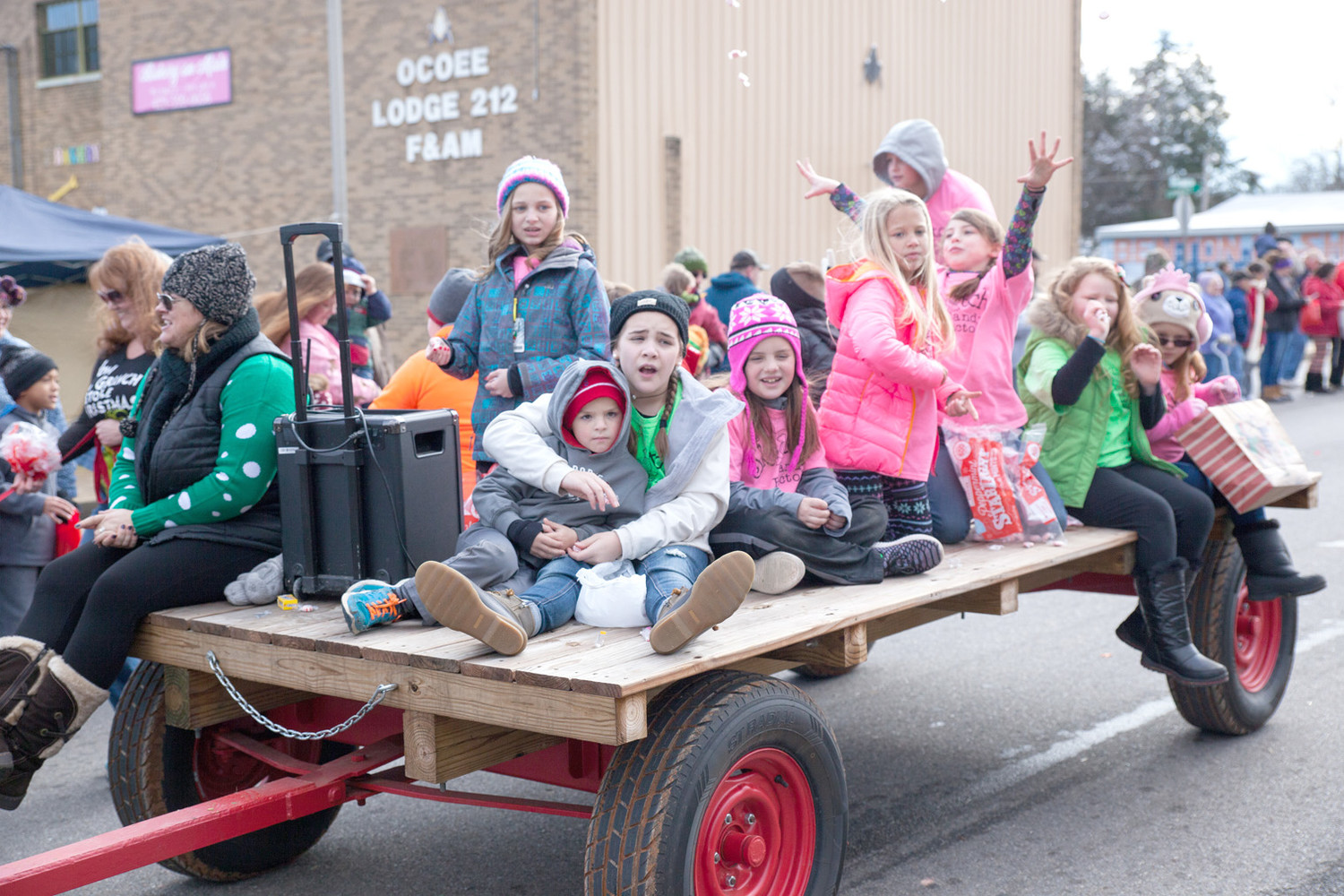 THIS FLOAT WAS BURSTING with Christmas Spirit as most sang carols and tossed candy out spreading cheer.
