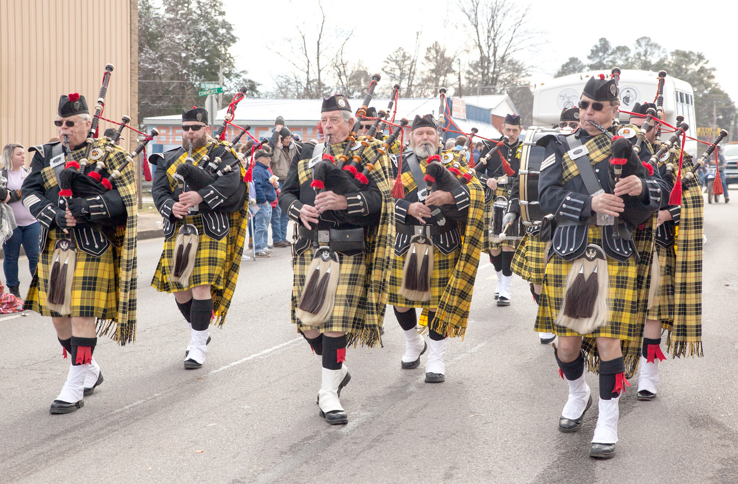 THE ALHAMBRA HIGHLANDERS Pipe and Drum group marched on the parade route during the Polk County Parade on Saturday.