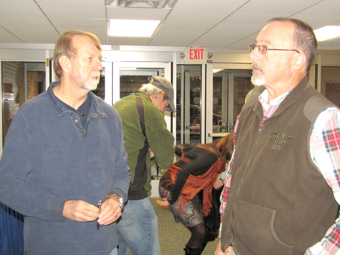 KEITH JENKINS, vice president of the Ocoee Outfitters Association, talks with state Sen. Mike Bell during TVA's public forum on the new whitewater use agreement.