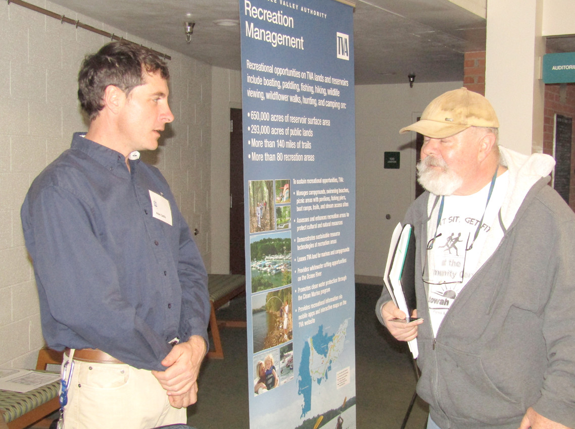 TVA Biologist Adam Datillo, left, talks with Bill Freeman of Etowah about the environmental impact of the new whitewater use agreement.
