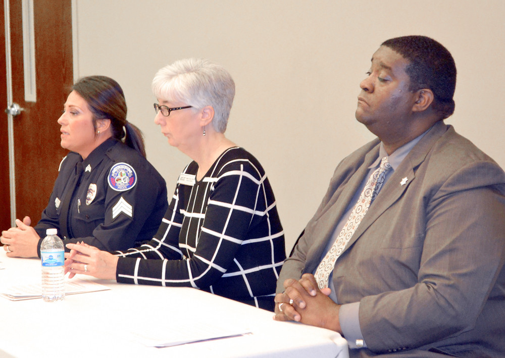 SGT. EVIE WEST, left, and Lt. James Bradford, right, joined ATS The Bridge Executive Director Reba Terry in announcing the tip411 app which provides a means to report, anonymously, information to law enforceemt.