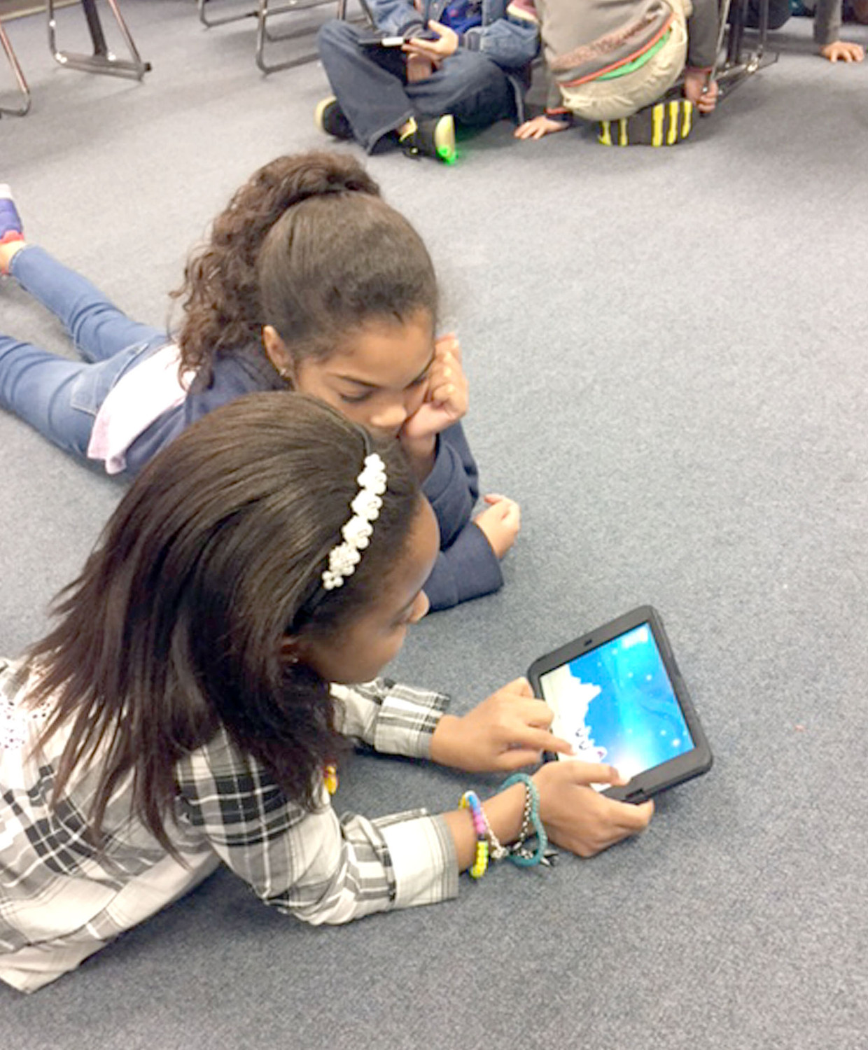 To celebrate computer science week, students in Mrs Ronda Phillips' technology class at Yates Primary worked on their coding skills. In the left photo, Amiya Smith and Layla Jones work as a team to reach their goal.