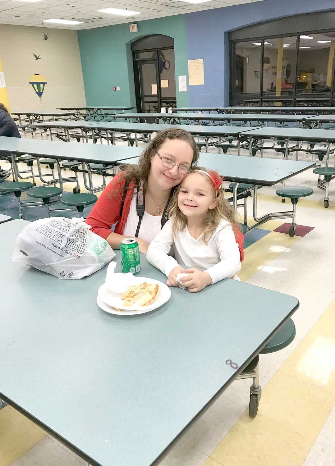 REGINA AND CEYANA BRACKNELL enjoyed some pizza during Christmas Dance and Fun Night at Blythe-Bower Elementary School.